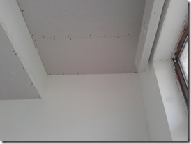 Raised ceiling and pelmet near window in Bedroom 1